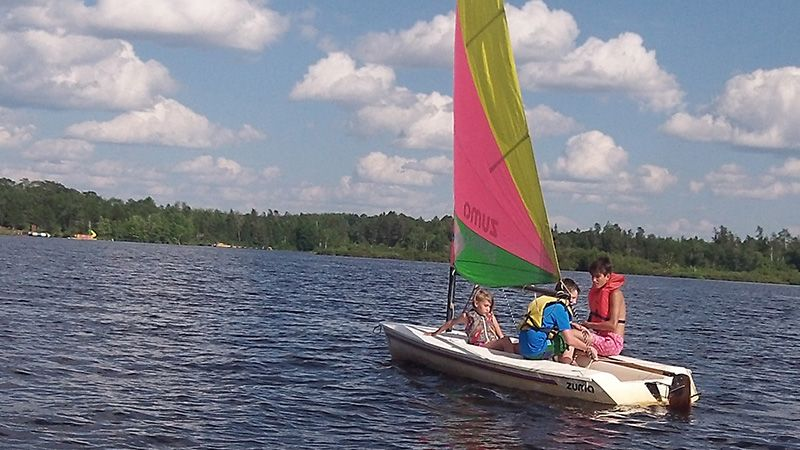 Summer Camp kids in sailboat